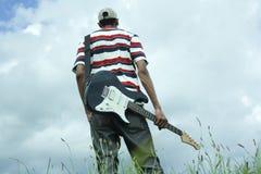 Hombre de la guitarra Imagenes de archivo