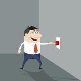 Hombre de la historieta que empuja un botón rojo Imagen de archivo