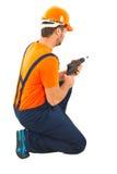 Hombre de la taladradora en el trabajo Fotografía de archivo