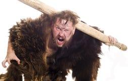 Hombre de las cavernas en piel del oso Fotos de archivo