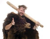 Hombre de las cavernas en piel del oso Imagenes de archivo
