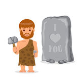 Hombre de las cavernas Varón cerca de la inscripción tallada en piedra El concepto de escritura prehistórica Imagen de archivo libre de regalías