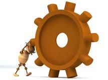 hombre de madera 3d que hace girar una rueda dentada Foto de archivo libre de regalías