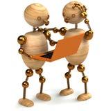 Hombre de madera con la computadora portátil anaranjada Imagen de archivo