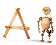 Hombre de madera con la letra a Foto de archivo libre de regalías