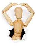 Hombre de madera inclinado fuera del agujero Imagen de archivo