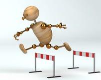 Hombre de madera que se ejecuta sobre barrera Foto de archivo libre de regalías
