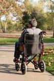 Hombre de mediana edad en sillón de ruedas fotos de archivo libres de regalías