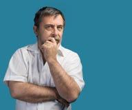 Hombre de mediana edad pensativo Fotos de archivo