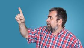 Hombre de mediana edad que señala con el finger Fotos de archivo libres de regalías
