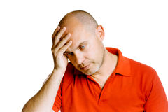 Hombre de mediana edad sin afeitar que lleva a cabo su cabeza Dolor de cabeza estudio ISO Imagen de archivo