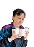 Hombre de mirada divertido con el papel higiénico Fotos de archivo libres de regalías