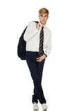 Hombre de moda joven con la chaqueta sobre hombro Imagenes de archivo