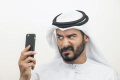 Hombre de negocios árabe enojado, hombre de negocios árabe que expresa cólera Imagenes de archivo