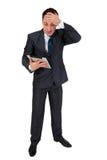 Hombre de negocios acertado aislado en blanco Fotografía de archivo