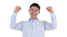 Hombre de negocios acertado Celebrating Win, fondo blanco Imagenes de archivo