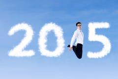 Hombre de negocios acertado con el número 2015 Foto de archivo libre de regalías