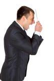 Hombre de negocios acertado joven en un traje de negocios, aislado en blanco Imagenes de archivo