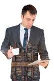 Hombre de negocios acertado joven en un traje de negocios, aislado en blanco Imágenes de archivo libres de regalías