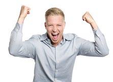 Hombre de negocios feliz que grita su éxito. Imagen de archivo libre de regalías