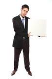 Hombre de negocios acertado y cartulina en blanco fotos de archivo