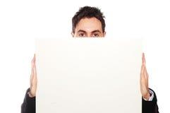 Hombre de negocios acertado y cartulina en blanco foto de archivo libre de regalías