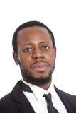 Hombre de negocios africano con una expresión seria Foto de archivo libre de regalías