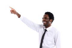 Hombre de negocios africano que presenta algo Imágenes de archivo libres de regalías