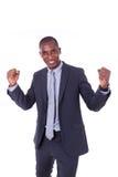 Hombre de negocios afroamericano con el puño apretado sobre la parte posterior del blanco Foto de archivo
