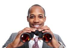 Hombre de negocios afroamericano con los prismáticos fotografía de archivo