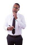 Hombre de negocios afroamericano que da una mano - personas negras imagen de archivo