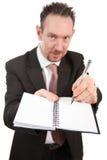 Hombre de negocios agresivo con el cuaderno y la pluma Foto de archivo libre de regalías