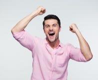 Hombre de negocios alegre que celebra su éxito Foto de archivo libre de regalías