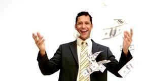 Hombre de negocios alegre que lanza su dinero metrajes