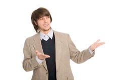 Hombre de negocios alegre que señala las manos Imagen de archivo libre de regalías