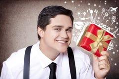 Hombre de negocios americano con el regalo mágico del recorrido. Foto de archivo libre de regalías