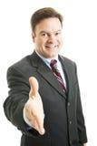 Hombre de negocios - apretón de manos cómodo Imagenes de archivo