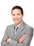 Hombre de negocios asertivo con los brazos plegables Imagen de archivo