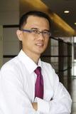 Hombre de negocios asiático acertado Imágenes de archivo libres de regalías