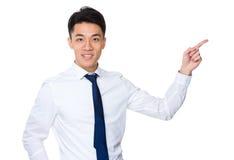 Hombre de negocios asiático con el destacar del finger Imágenes de archivo libres de regalías