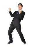 Hombre de negocios asiático con muy la salida de postura en blanco. Fotografía de archivo