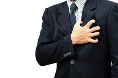 Hombre de negocios asiático con síntomas del corazón Imagenes de archivo
