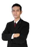 Hombre de negocios asiático confiado joven, aislado en blanco Imagen de archivo
