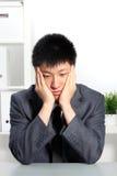 Hombre de negocios asiático desanimado foto de archivo libre de regalías