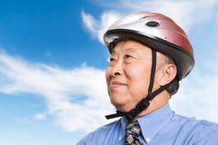 Hombre de negocios asiático mayor activo Imágenes de archivo libres de regalías