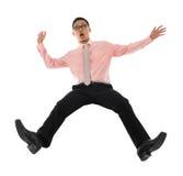 Hombre de negocios asiático que cae al revés Fotografía de archivo libre de regalías