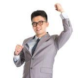 Hombre de negocios asiático que celebra éxito Imágenes de archivo libres de regalías