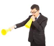 Hombre de negocios asiático que grita con el megáfono que anima Imágenes de archivo libres de regalías