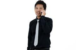 Hombre de negocios asiático que llama un teléfono Fotografía de archivo