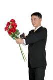 Hombre de negocios asiático Standing con sostener un ramo de Rose Flower Imagen de archivo